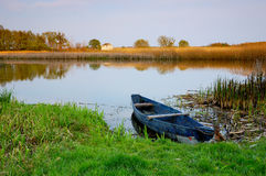 River and boat. Old boat made fast on the river of Ros'. Ukraine Stock Images