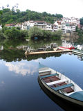 River boat. Blue/white boat in a river, in the city of Amarante, Portugal Royalty Free Stock Image