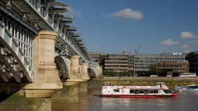 River Boat Blackfriars and St Pauls. Camera follows a Thames river boat from Blackfriars Bridge to St Pauls Cathedral. Shot in 4K on a sunny afternoon stock video