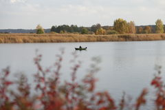 River, boat, fishing, autumn Royalty Free Stock Photo