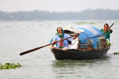 River boat. On one of the many rivers in Bangladesh we saw these men paddling their boat home Stock Photos