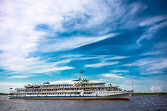 River boat. Passenger ship on the river in the background beautiful blue sky Royalty Free Stock Photos