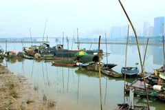 The river boat. The riverside river, calm water, fishing boat moored at the shore, fog, beautiful scenery Stock Images