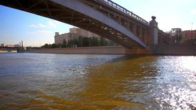 River boat sailing under the bridge. Tour on sunny stock footage