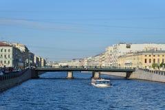 River boat sails under Semenovsky bridge over Fontanka Stock Photo