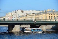 River boat sails under Semenovsky bridge over the Fontanka Stock Image