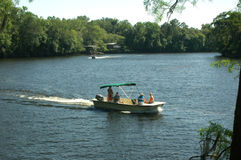River Boating 1. A family enjoys boating on the Suwannee River Royalty Free Stock Photos