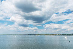 River with boats and low dramatic sky over it Royalty Free Stock Image