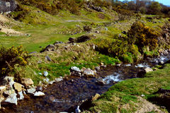 River in Bodmin Moor area near old mining shaft Stock Photo