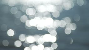 River and bokeh balls. Bright shiny river is in focus and out of focus with bokeh balls stock footage
