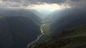 River at the Bottom of a Huge Canyon. Time Lapse. Fantastically beautiful deep gorge at the bottom of which flows a winding river stock video footage