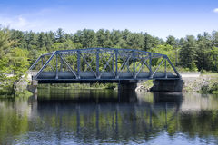 River Bridge. Steel bridge over a quiet river Royalty Free Stock Photo