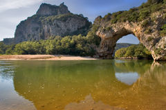 The river and the bridge. The natural stone bridge through the river in Provence Stock Image