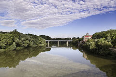 River with bridge and building. Panoramic view of a river bridge and building in the background Stock Photography