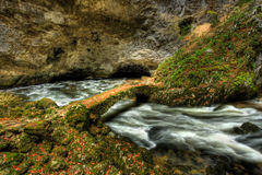 River and bridge in cave. On Slovenian Karst Stock Images