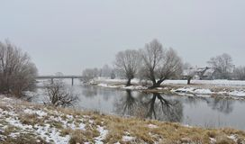 River, bridge, home  and beautiful white trees in frost, Lithuania Royalty Free Stock Photography