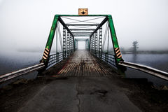 River Bridge. Old bridge over a foggy river stock photos