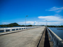 River bridge One day in the blue sky. The left is a green mountain. Stock Photos