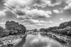 River and bridge in Paris, France on sunny day. On cloudy blue sky background. Ships on water. Green trees on banks. Landmark and tourist destination. Summer Royalty Free Stock Photos