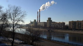 River with bridge and pipe smoke in Moscow in stock footage