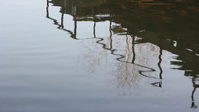 River, bridge reflection in water, trees and sun. stock footage