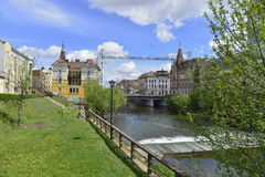 Somes river, bridge, river bank and historical buildings in Cluj-Napoca. The Somes river bank with bridge from Cluj-Napoca city from Romania, Europe. Three stock photography