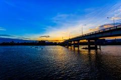 River Bridge. Tha Chin River Bridge in the evening in Thailand royalty free stock photos