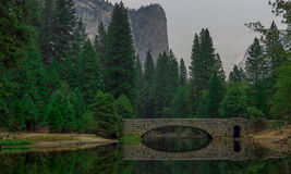 River bridge, trees and mountain Stock Image