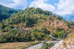 River bridge way to the mountain. Nepal Royalty Free Stock Photos
