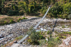 River bridge way to the mountain. Nepal Stock Images