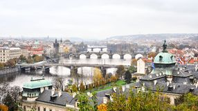 River and bridges in Prague. Under a cloudy sky royalty free illustration