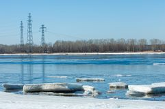 River With Broken Ice.energy pillars. ice hummocks on the river royalty free stock photo