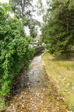 River in Bulgarian Koprivshtitsa. Mountain eco-village Koprivshtitsa - Bulgarian national carpet center, rural tourism, national rural architecture and a popular Royalty Free Stock Photo
