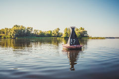 River buoy amid the calm water of the river Dnieper Stock Images