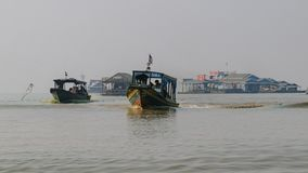 River buses serving the community at the floating town in Tonle-Sap stock image