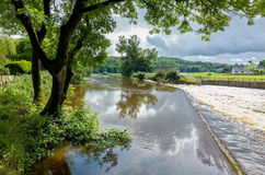 River Calder in Lancashire, England. Weir on the River Calder in Lancashire, England, UK royalty free stock image