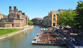 The river Cam at Cambridge with punts and Magdalene College. royalty free stock image
