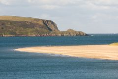 River Camel estuary, Cornwall. The river Camel estuary looking to sea with Stepper Point to the left on the north Cornwall coast, UK Royalty Free Stock Image