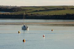 River Camel yacht Padstow, Cornwall. A yacht moored on the river Camel at Padstow, Cornwall Stock Image