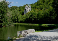 River and canal boat, canal du Nivernais, burgundy. On the Velo, cycling track, canal and river boat on the canal de nivernais, near Cravant. Rock formations Royalty Free Stock Image