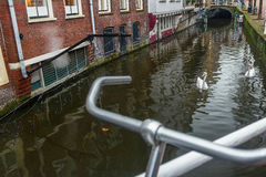 River canal and street with bicycle parking lot in Dutch Delft old city Stock Image