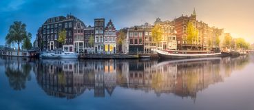 River, canals and traditional old houses Amsterdam Royalty Free Stock Image