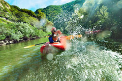 In river canoe splashes Stock Photo