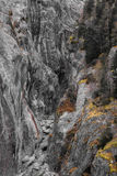 River canyon enclosed by weathered grey granite cliffs Stock Photography