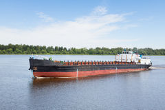River cargo ship goes along the Volga River Royalty Free Stock Images