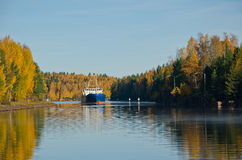 River Cargo Ship. Cargo ship moving down the river autumn morning Stock Photography