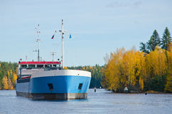 River Cargo Ship. Cargo ship moving down the river autumn morning Stock Photo