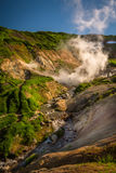 River and cascades between thermal features of Mutnovsky Volcano Stock Photos