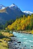 River in Caucasus. This is emerald river in Caucasus mountains in autumn Stock Photos