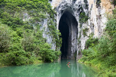 River & Cavern. The Getu river flows from the Yanzhi cavern stock photo
